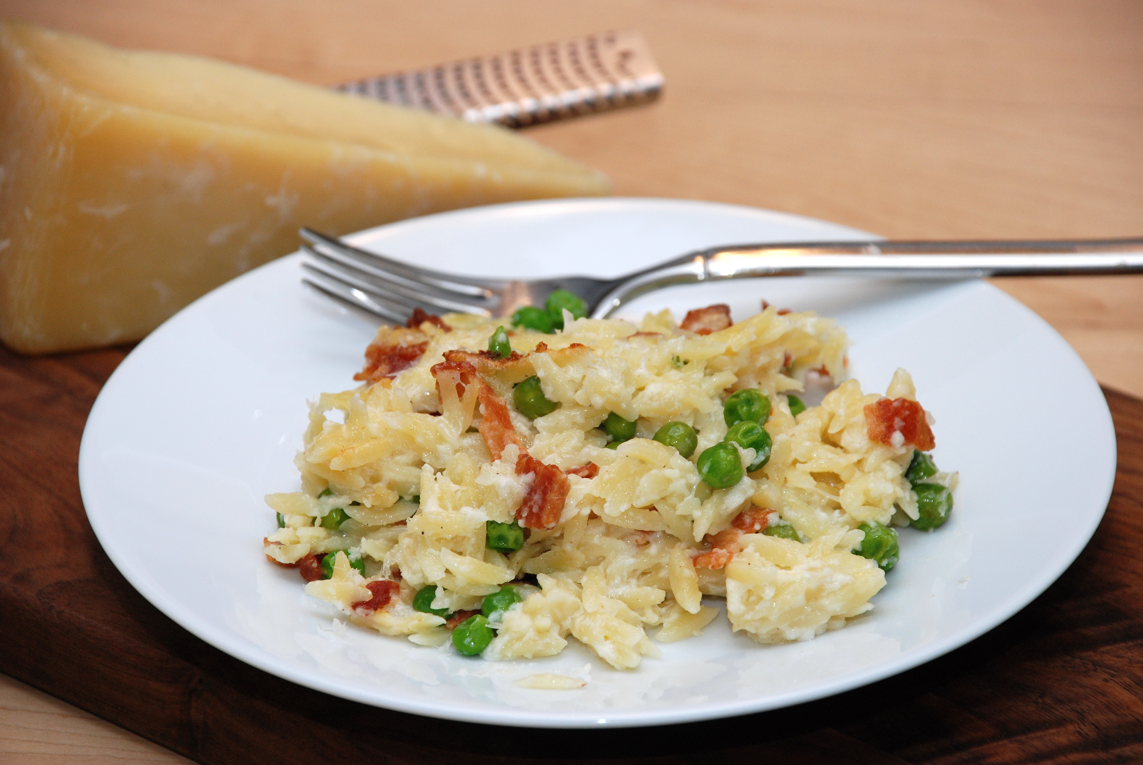 Cheesy Baked Orzo with Bacon and Peas